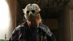 Scary halloween mask jason horror hallway Stock Footage