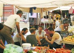 turks paying cards at street bazaar alanya turkey - stock photo