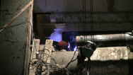 Stock Video Footage of Welder works on Construction of concrete buildings at night