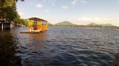bamboo raft floats on lake - stock footage