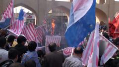 Iran, crowd burns American flag and chants 'death to USA' - stock footage