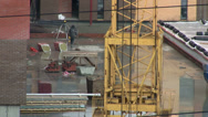 Stock Video Footage of Construction of concrete buildings with crane construction after rain