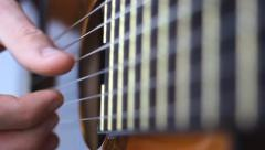 Fingerstyle guitar playing Stock Footage