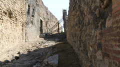 Small street in Pompeii with scaffolding to hold wall Stock Footage