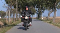 Senior man riding his motorcycle. Stock Footage