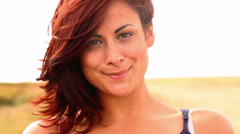 Gorgeous content brunette smiling at camera - stock footage