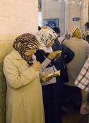 Believers praying at mevlana konya turkey Stock Photos