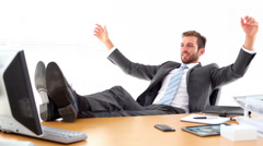 Relaxed businessman putting his feet up - stock footage
