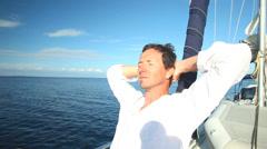 Man enjoying a sailing trip on the adriatic sea off the Croatian coast Stock Footage