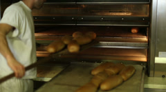 Baked bread out of the oven in a bakery 5 Stock Footage