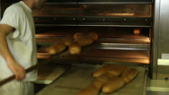 Stock Video Footage of baked bread out of the oven in a bakery 5