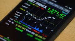 Stock market on smart phone Stock Footage