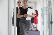 Stock Photo of Business woman walking down corridor