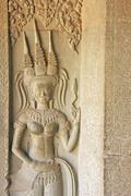Wall bas-relief of devata, angkor wat temple, siem reap, cambodia Stock Photos