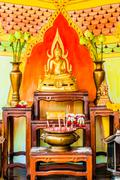 buddha altar in a budhist temple - stock photo