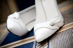 Shoes of the bride Stock Photos