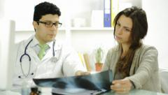 Young Doctor Explaining Treatment to Female Patient Xray Stock Footage