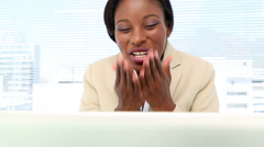 Delighted businesswoman on video chat Stock Footage
