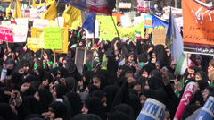 Iran, anti America protest, girls and women in chadors chant slogans - stock footage