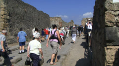 Tourists walking through Pompeii Stock Footage