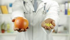 Fruit Versus Pills Choice Doctor Hands Stock Footage