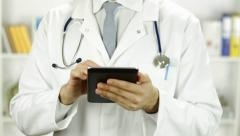 Doctor Torso Working with Tablet PC Research Concept - stock footage