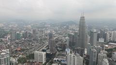 Kuala Lumpar - Petronas Towers & City pan Stock Footage