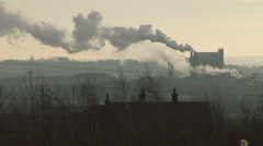 Chimneys smoke in industrial setting - stock footage