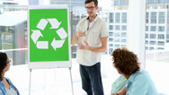 Stock Video Footage of Man present environmental awareness plan to colleagues