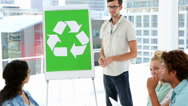 Stock Video Footage of Man present environmental awareness plan to coworkers