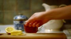 Preparing black tea with lemon Stock Footage