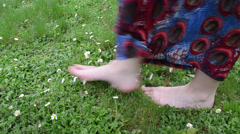 Barefoot woman with dress walk meadow full of daisy flowers Stock Footage