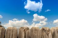 Stock Photo of Fence with clouds