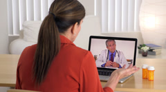 Mature patient talking with senior doctor on computer - stock footage