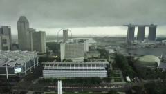 Singapore- Rain engulfs Singapore flyer  from the barrage Stock Footage