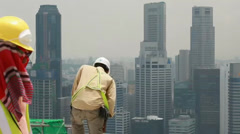Singapore construction ,manager looks back from Marina Bay Sands Stock Footage