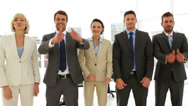 Stock Video Footage of Business people giving thumbs up standing in a row