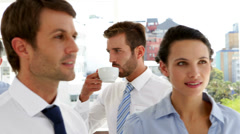 Business people drinking coffee and chatting at conference - stock footage