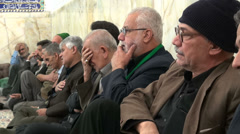 Iran, religion, Islam, senior muslim men cry for martyrdom Hussein - stock footage