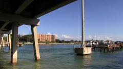 Pan under bridges to boats - stock footage