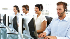 Customer service agents working - stock footage
