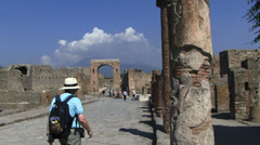 Person walking towards mount vesuvius Pompeii Stock Footage