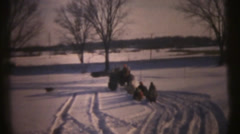 1950's & 60's  vintage, Farm tractor in snow Stock Footage