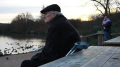 Pensioner with crutches thinking about life (dolly) Stock Footage