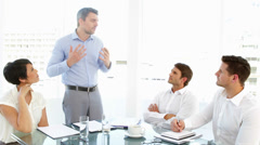Boss storming off in anger during meeting - stock footage