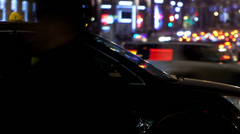 Timelapse of city traffic at night behind taxi car Stock Footage