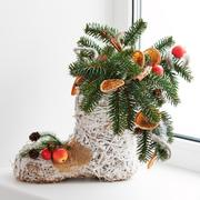 Christmas arrangement of felt boot decorated with toys. Stock Photos