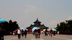 The visitors walk along the central road in Temple of Heaven of Beijing, China Stock Footage