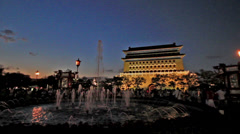 The fountain and Zhengyang Tower at Qianmen in Beijing, China Stock Footage