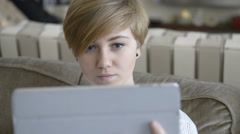 Teen on Tablet with Surprised Expression Stock Footage